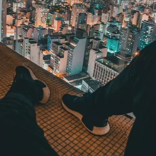 shoes looking over city