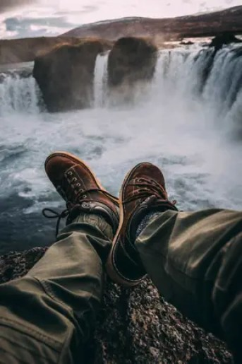 shoes over waterfall