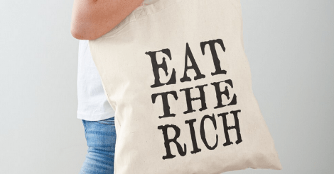 "Redbubble product image has been cropped to show a tote bag of uncolored canvas. In large plain black type that looks like an old typewriter, in all-caps, it says ""Eat The Rich."" Stylish."