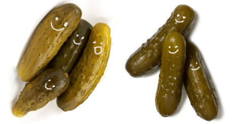 An image showing two piles of little pickles, all with happy faces drawn on them. The left has four pickles. The right has three pickles. They really are dill or sweet gherkin. It seems to be impossible to tell.