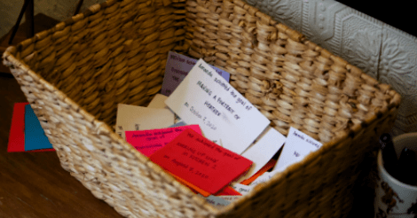 A small little basket contains slips of many colors!
