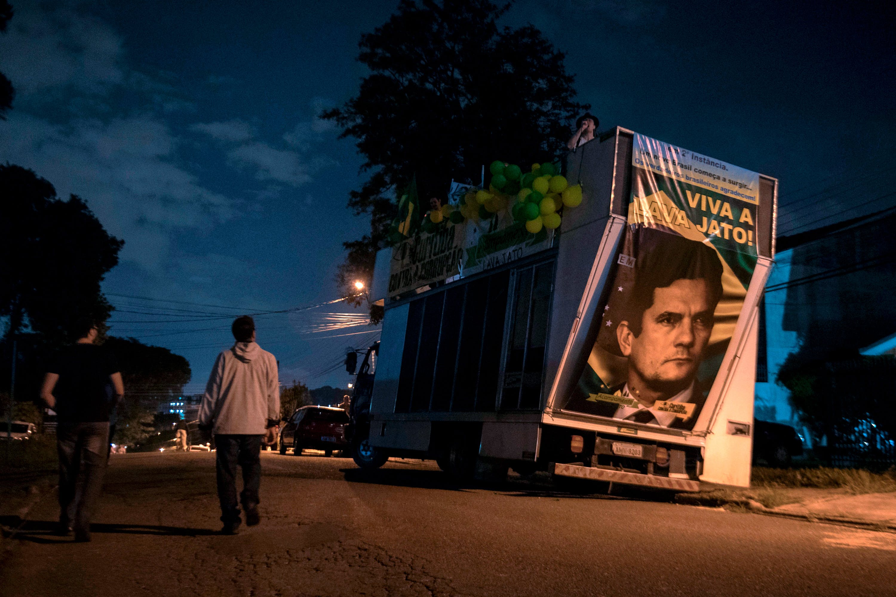 """View of a truck with a portrait of Brazilian judge Sergio Moro reading """"Long live Lava Jato"""", referring to an anti-corrption operation, during a protest against Brazilian former president (2003-2011) Luiz Inacio Lula Da Silva outside the Federal Police headquarters, where he is awaited to start his 12-year prison sentence in Curitiba, Parana, Brazil. Lula da Silva, the controversial frontrunner in Brazil's October presidential election, remained defiantly holed up Friday as a deadline for him to surrender and start a 12-year prison sentence for corruption loomed."""