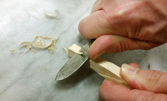 Shave off 1/4 tsp of wood shavings to place in the chamber of the Smoking Gun. Photo by Susan Whitney.