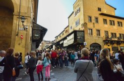The crowd on Ponte Vecchio. There are shops along the bridge.