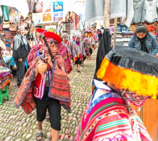 Local Elders arrive Sunday mass Pisac Sacred Valley Peru