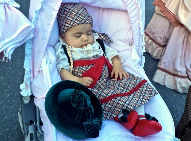 Sleeping baby in handmade costume. Photo © Karethe Linaae