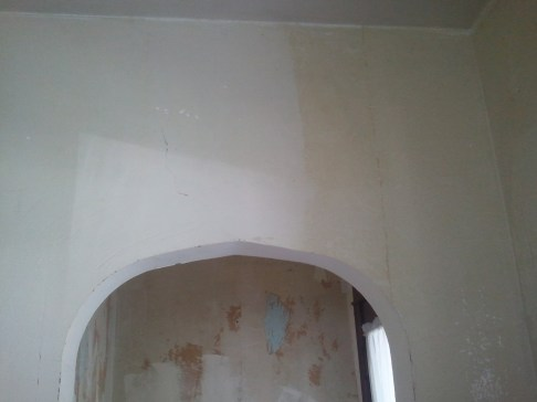 Can you see the line? This shows the glue cleaned off the walls. Soon we will be able to prep the walls for paint.