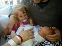 Olive holding Eli