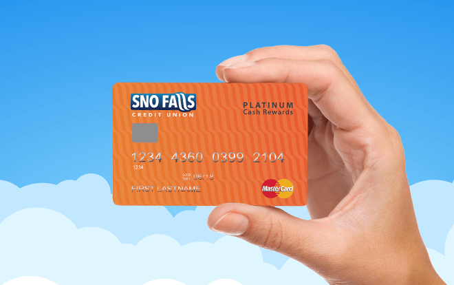 Hand holding Sno Falls Platinum Cash Rewards credit card.