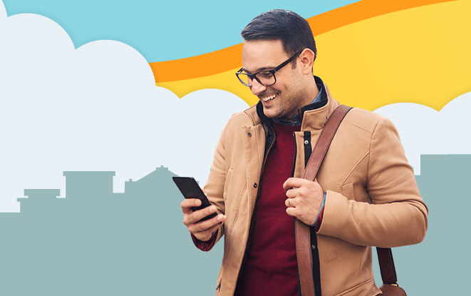 Man smiling at his phone in front of illustrated skyline at sunset