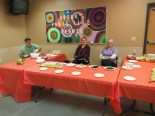 SCFS Members ready at the Strawberry & Banana table where they made Santas and Grinches.
