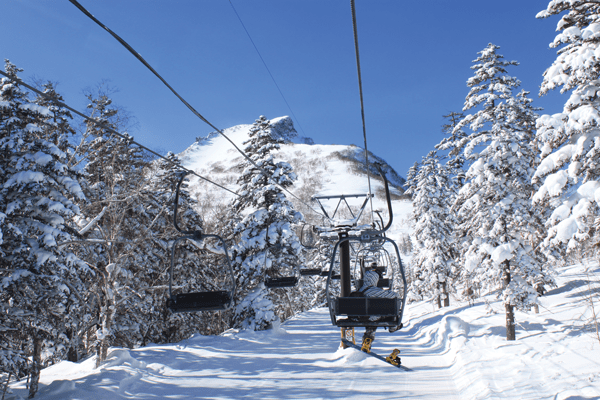 View up the short double chair above the gondola (tram) to the peak © James Mutter