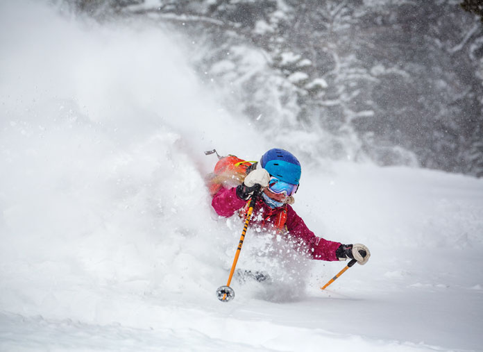 Jess McMillan surging powder at Jackson Hole