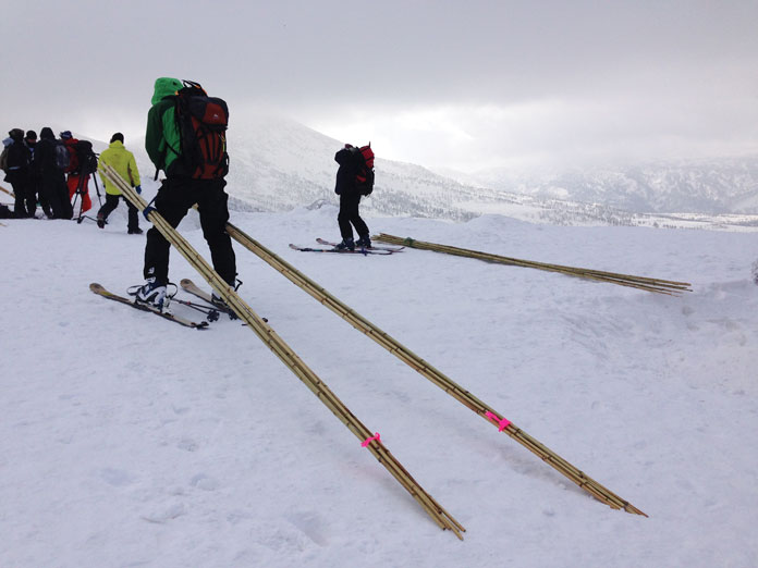 Guides poling out backcountry routes at Hakkoda