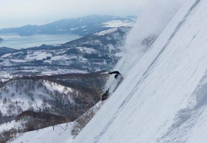 Peter Wunder hitting a super steep Hokkaido backcountry line on his Gentemstick Super Fish board