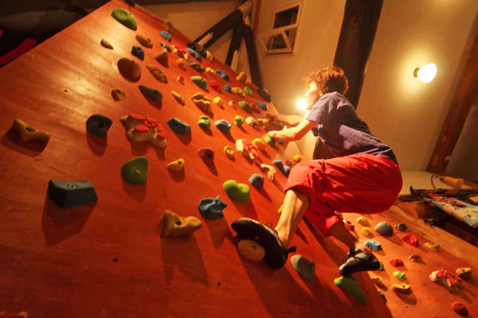 climbing wall in the lounge at Clubman Lodge