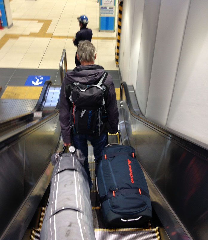 Riding escalator in Tokyo hauling ski bags you want a lightweight breathable jacket