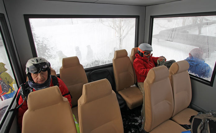 Inside Hachimantai Cat Tours snow cat the cabin has full seats for all clients