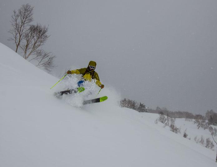 Hachimantai Cat Skiing guide Junya Kuragane charging hard in the powder snow on Mt Chausu