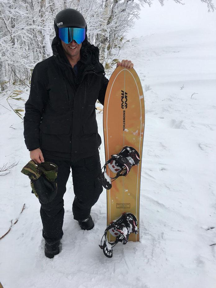 Showing the MOSS Snowstick board on snow in Hokkaido