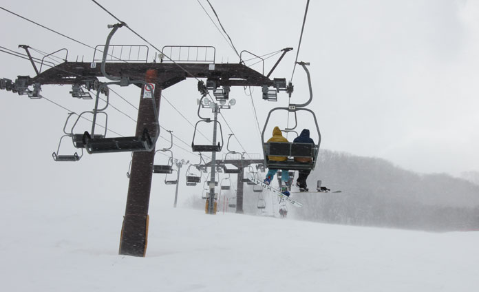 Riding the middle double chairlift at Okutone Snow Park