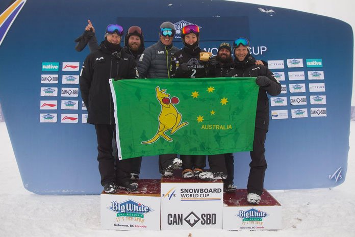 Belle Brockhoff shows the boxing kanagaroo flag on the podium at Big White World Cup Boarder Cross