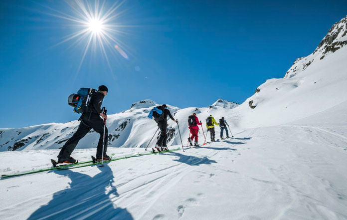 Skiing up on a Swiss Ski Tour north to south from Andermatt to Locarno