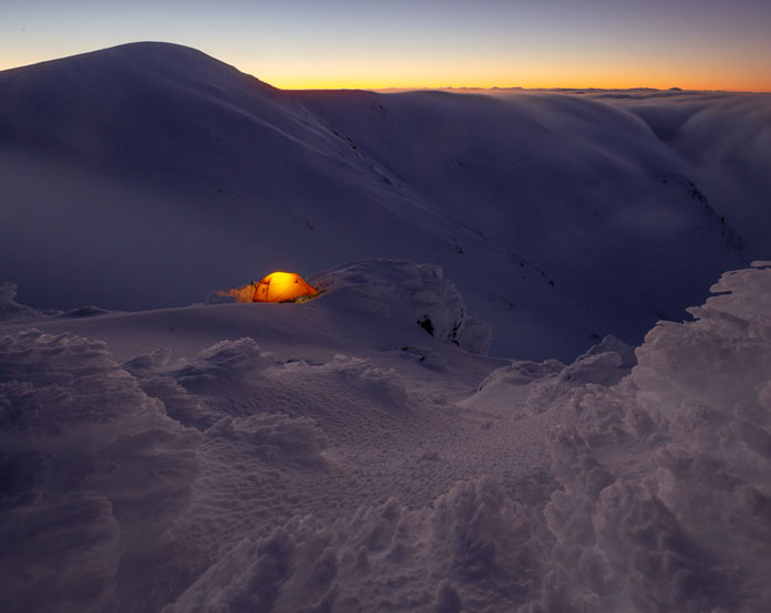 Night falls over snow camp on the Main Range
