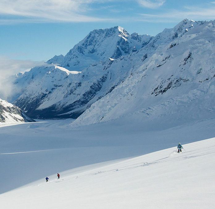 Skiing the Tasman Glacier with views to Aoraki / Mt Cook