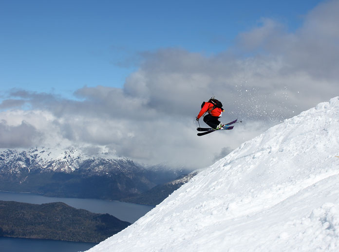 Skier with lake view at Cerro Bayo Argentina