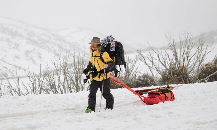 Hank Bilous heads out towing sled at start of filming the North Face 'Western Faces' short movie