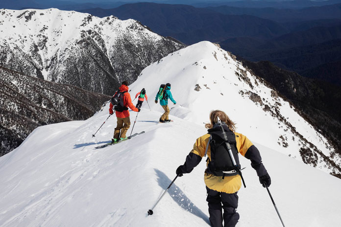Group skiing Sentinel Ridge during filming of The Western Faces movie