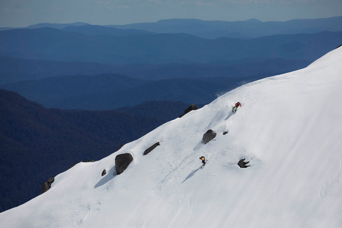 Tim Macartney-Snape at 63 foloowing 22 year old FWT star Hank Bilous in a steep Western Faces ski line