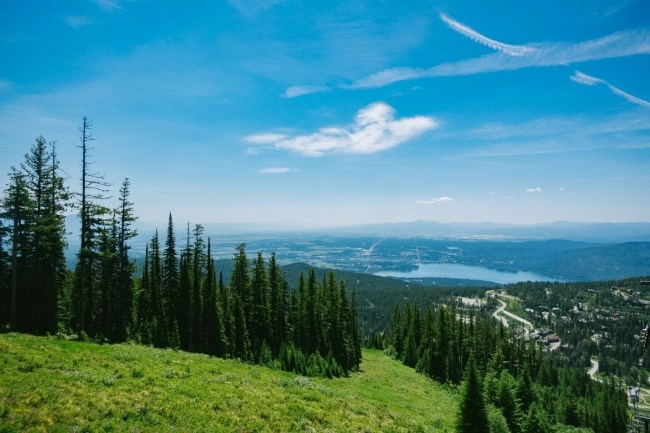 Heading to the summit of Whitefish Mountain, looking down at Whitefish Lake