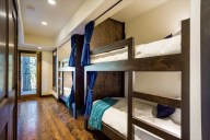 On the lower level, you'll find four private bunks with reading lights and USB ports [Cedar]