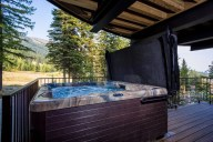 Relax with stunning views in your private hot tub on the lower patio [Cedar]