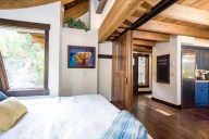 The cantilevered master bedroom features sliding barn doors for privacy whenever desired [Tamarack]