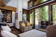 Slide the doors open for summertime indoor-outdoor living up in the trees [Tamarack]