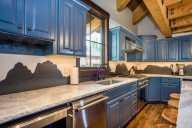 Gorgeous kitchen finishes with a custom mountain backsplash [Cedar]
