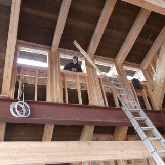 Henry poking his head indoors while installing the roof on Ponderosa