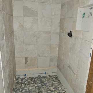 The first of 8 showers to be tiled- thanks Zach!