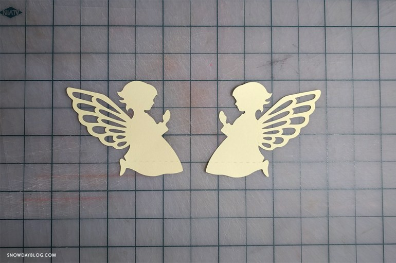 Two baby angels cut out