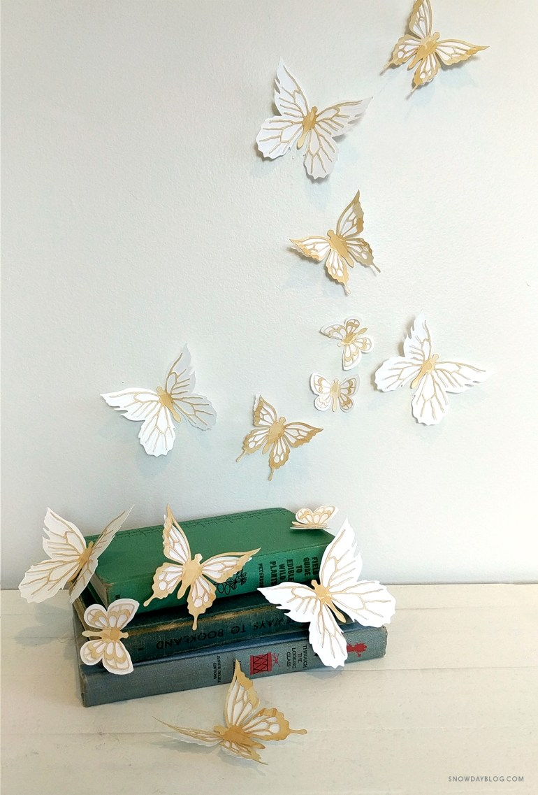 tea stained butterfly stickers in vintage books setting