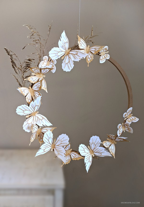 Hanging wreath made of tea stained butterfly stickers