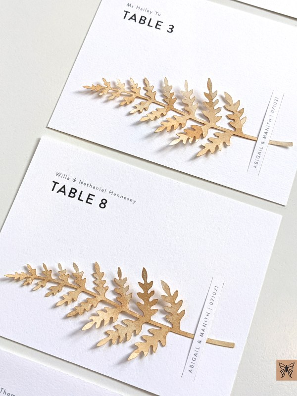 Table number cards with fern leaves