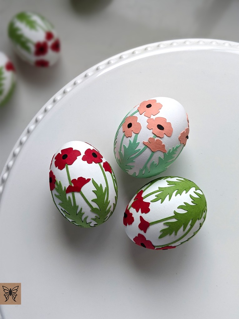 Red and salmon poppies on Easter Eggs