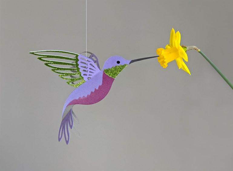 Purple hummingbird decoration with flower