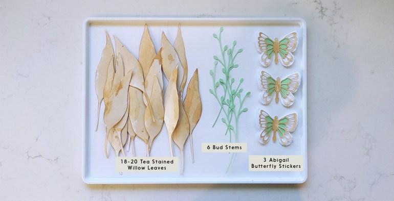 Willow leaves and butterfly paper cutouts
