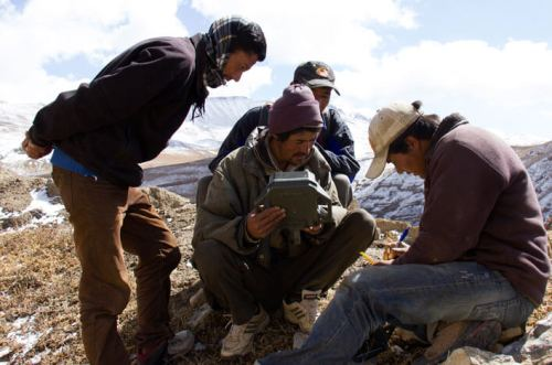 A team of snow leopard researchers is setting up remote-sensor cameras in the Himlayas to monitor snow leopard populations.