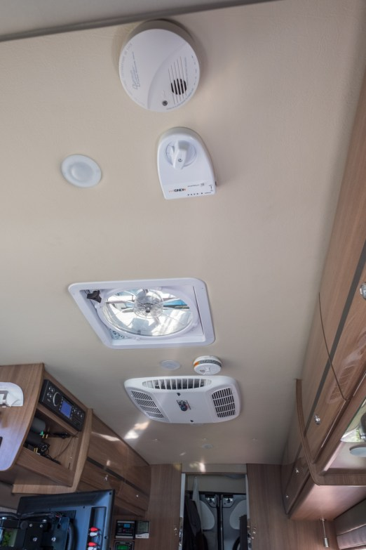 The ceiling fixtures, with TV antenna, Maxxair fan with built in rain cover, and air conditioner from front to back
